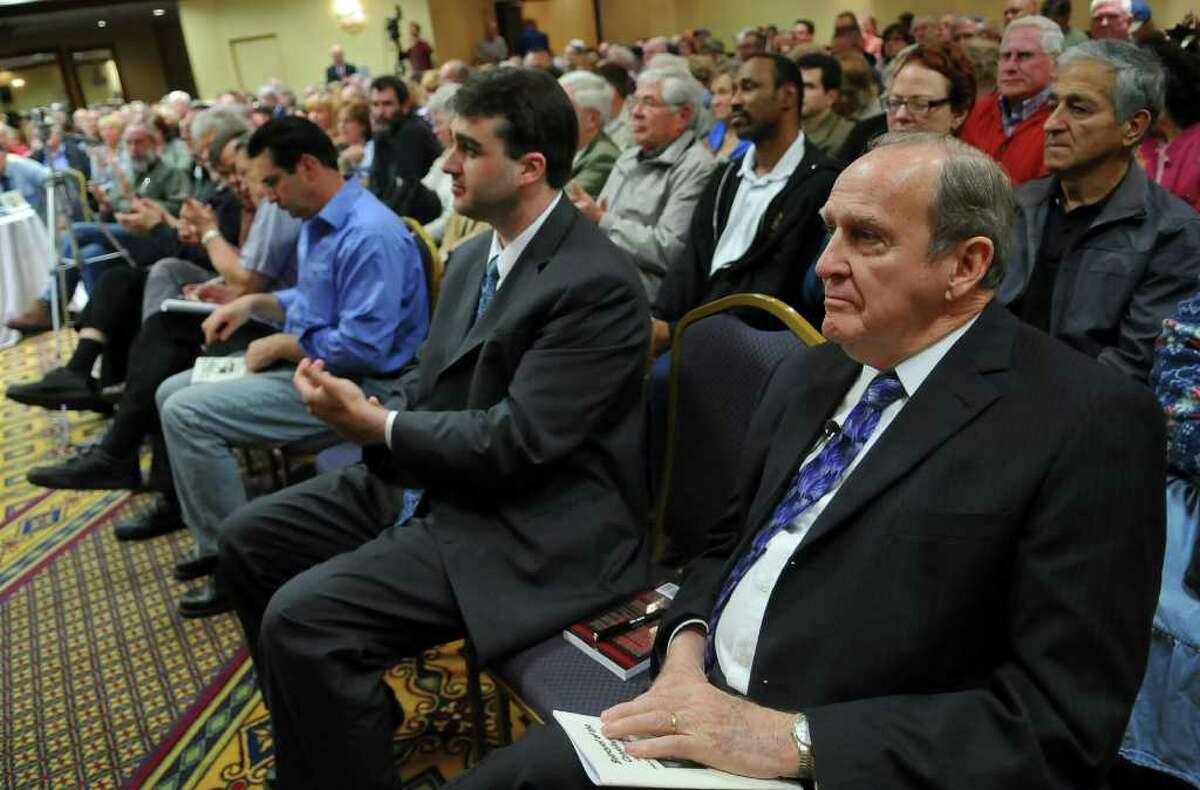 John F. McManus, President of the John Birch Society, right, listens to introductions before giving a speech at the Albany Marriott on Monday night May 2, 2011 in Colonie, NY. ( Philip Kamrass / Times Union )