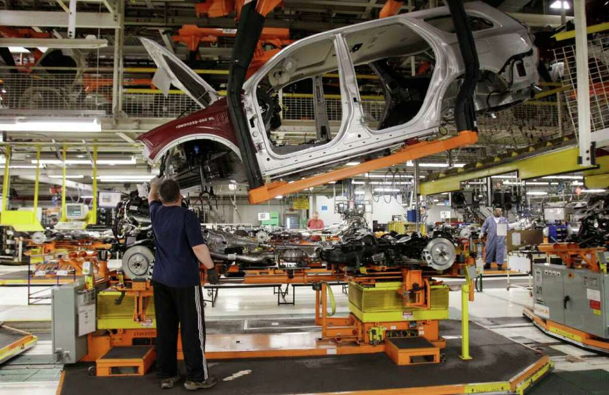 In this April 28, 2011 photo, a Dodge Durango is assembled at Chrysler's Jefferson North Assembly Plant in Detroit. Manufacturing grew for the 21st straight month in April, though at a slightly slower pace than the previous month (AP Photo/Carlos Osorio)