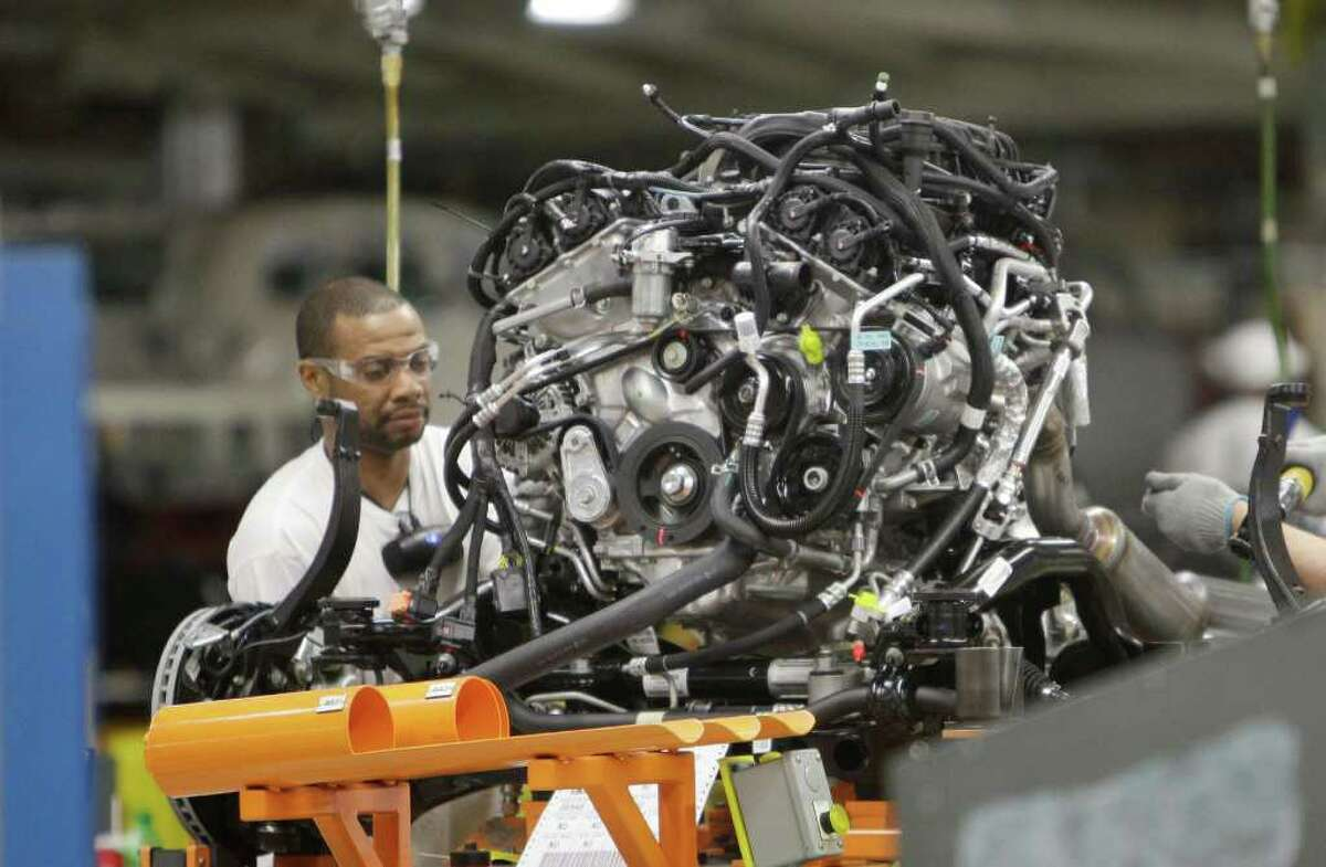FILE - In this April 28, 2011 file photo, an assemblyman works on an engine for the Chrysler Jeep or the Dodge Durango which are built on the same line at Chrysler's Jefferson North Assembly Plant in Detroit. The company reported first-quarter net income of $116 million and revenues of $13.1 billion on Monday, May 2, 2011. The profit is a milestone in Chrysler's long road back to health after its 2009 bankruptcy. It last reported a profit in 2007. (AP Photo/Carlos Osorio)
