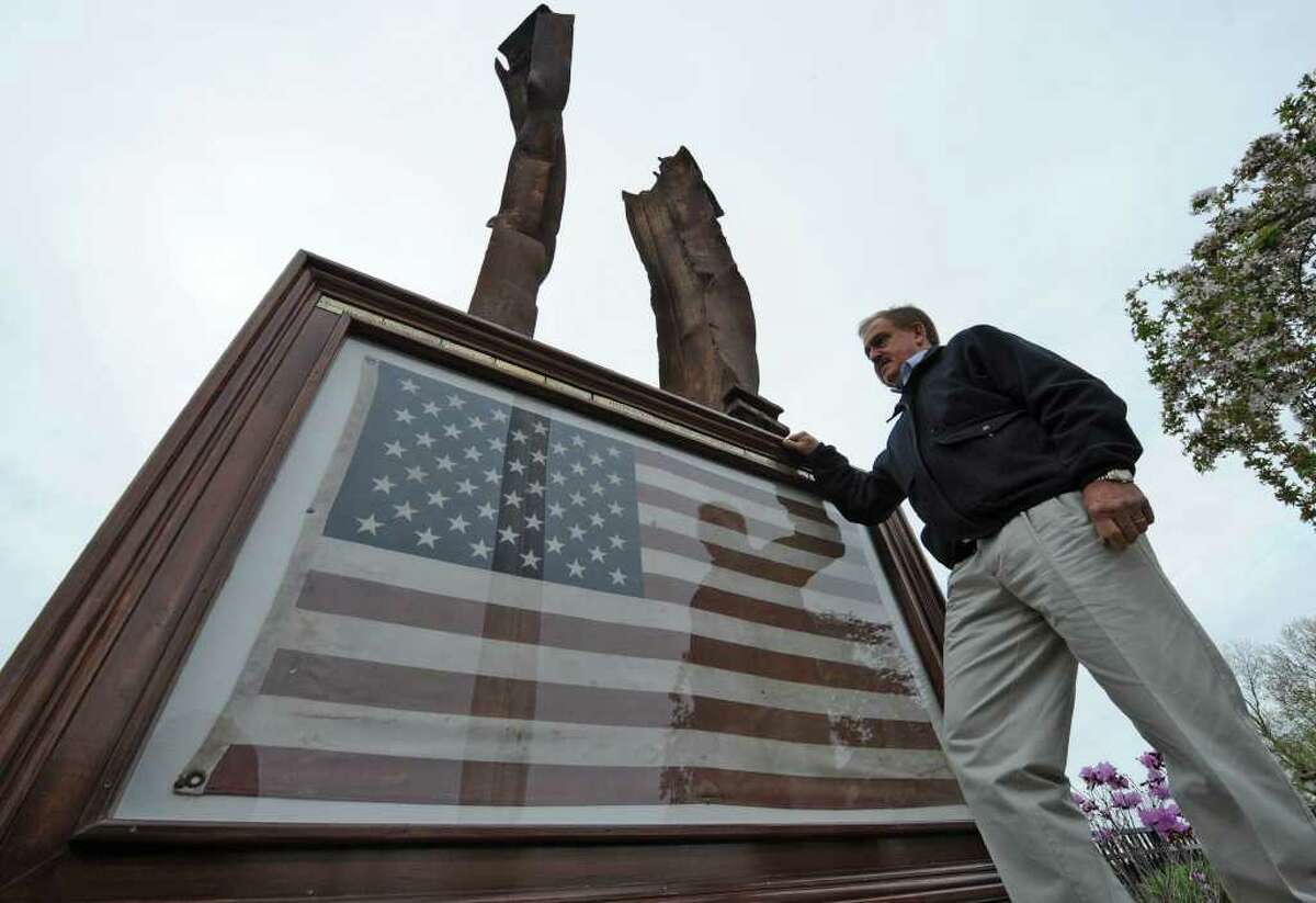 Pat Popolizio stands by the 911 memorial he set up on the grounds of hisWater's Edge Lighthouse and Banquet Center in Scotia, N.Y. May 1, 2011 the day of the confirmation of Osama Bin Laden's death. (Skip Dickstein / Times Union)
