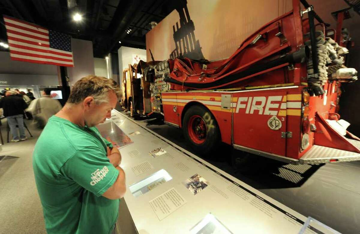 Rich Fisher looks over some of the artifacts from the Sept. 11, 2001 attack that are on display in the State Museum in Albany on May 1, 2011. It was the day after terror mastermind Osama bin Laden was killed by U.S. Special Forces. (Skip Dickstein / Times Union)