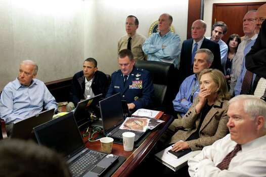 In this image released by the White House and digitally altered by the source to diffuse the paper in front of Secretary of State Hillary Rodham Clinton, President Barack Obama and Vice President Joe Biden, along with with members of the national security team, receive an update on the mission against Osama bin Laden in the Situation Room of the White House, Sunday, May 1, 2011, in Washington. (AP Photo/The White House, Pete Souza) Photo: Pete Souza