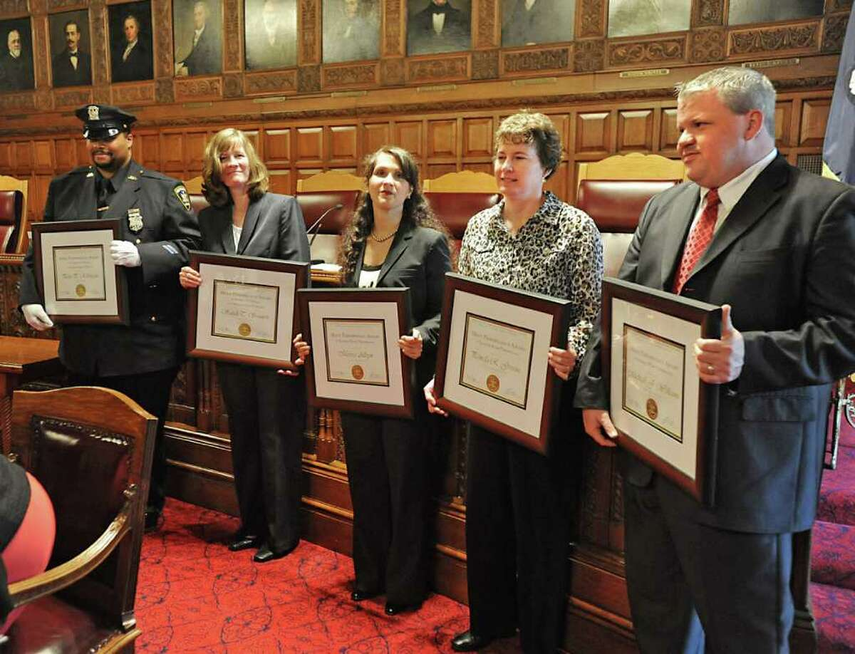 The recipients for the 2011 Merit Performance Award, the highest honor bestowed upon employees of the New York State court system, stand with their awards in the State Court of Appeals in Albany, N.Y. on Law Day, Monday May 2, 2011. From left, Peter Robinson, Court Officer, Niagara County Supreme Court, Sarah Sennett, Deputy Chief Clerk, Monroe County Surrogates's Court, Marisa Alleyn, Senior Court Analyst, Nassau County Supreme Court Matrimonial Center, Pamela Greene, Associate LAN Administrator, Sixth Judicial District Office, and Michael Williams, Deputy Chief Clerk, Bronx County Family Court. (Lori Van Buren / Times Union)