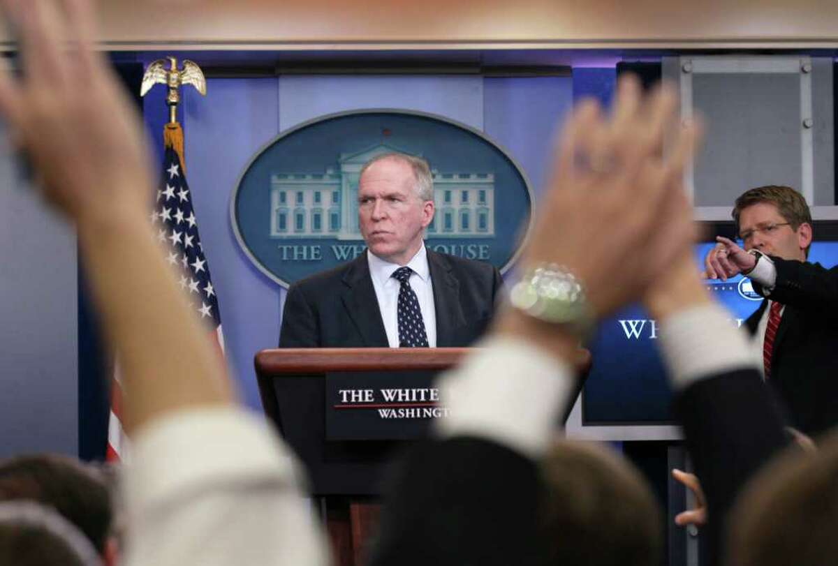Deputy National Security Adviser for Homeland Security and Counterterrorism John Brennan, left, and White House Press Secretary Jay Carney participate in the daily news briefing at the White House, Monday, May 2, 2011, in Washington. (AP Photo/Carolyn Kaster)