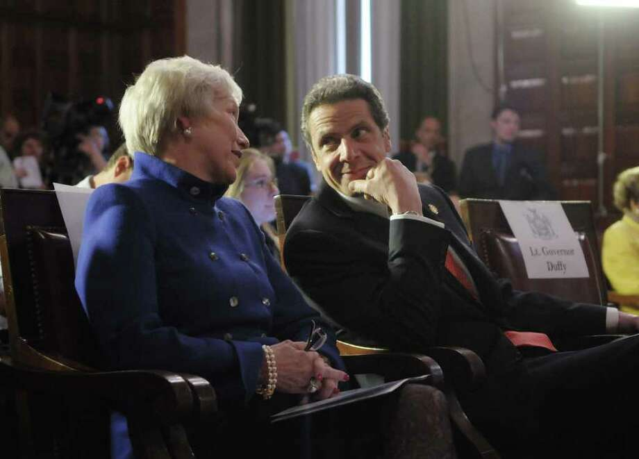 Nancy  Zimpher, left, chancellor of SUNY, talks with Governor Andrew Cuomo  during a press conference at the capitol on Monday afternoon, May 2, 2011 in Albany.  The press event was held by the Governor to unveil the NYSUNY 2020 Program, a challenge grant program meant to push SUNY into becoming a catalyst for job growth throughout the state. (Paul Buckowski / Times Union) Photo: Paul Buckowski  / 00013005A