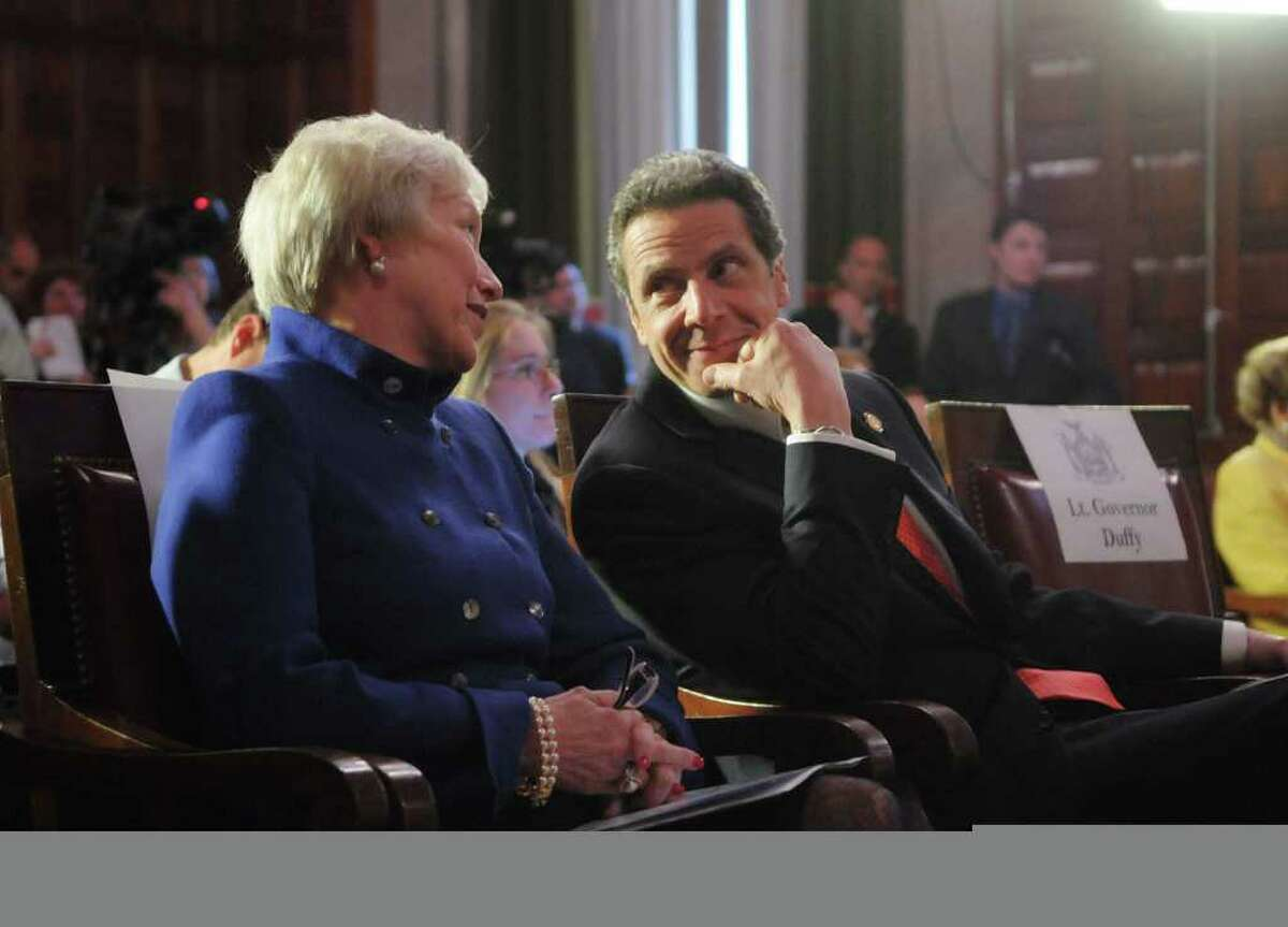 Nancy Zimpher, left, chancellor of SUNY, talks with Governor Andrew Cuomo during a press conference at the capitol on Monday afternoon, May 2, 2011 in Albany. The press event was held by the Governor to unveil the NYSUNY 2020 Program, a challenge grant program meant to push SUNY into becoming a catalyst for job growth throughout the state. (Paul Buckowski / Times Union)