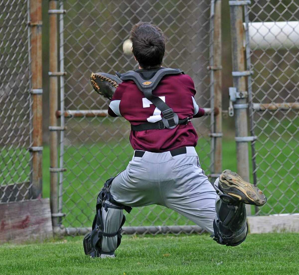 Burnt Hills catcher Dave Russell dives to catch a foul pop behind home plate near the fence during a game against Averill Park on Monday May 2, 2011 in Burnt Hills, NY. ( Philip Kamrass / Times Union )