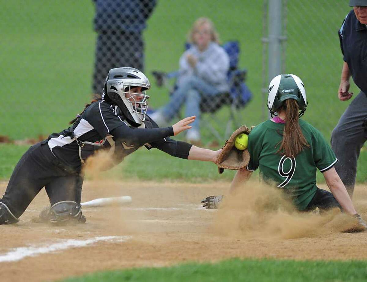 Bethlehem catcher Sammy Smaldone tags out Shenendehowa's Melissa Morgan at home plate during a softball game in Clifton Park, N.Y. Monday May 2, 2011. (Lori Van Buren / Times Union)