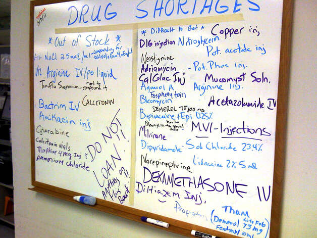 A white board outside the office of Mark A. Richerson, director of pharmacy for Christus Santa Rosa Health Care, lists prescription drugs that are in short supply. Drug shortages are becoming increasingly common nationwide. Photo: Richard A. Marini/rmarini@express-news.net