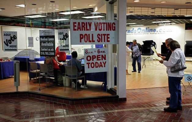 A slow but steady stream of voters study sample ballots and cast votes Monday, at the early voting site at Wonderland of The Americas mall. Photo: Express-News File Photo / THE SAN ANTONIO EXPRESS-NEWS