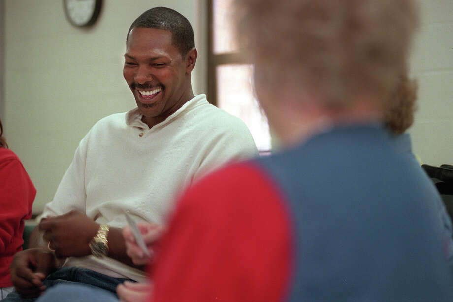 Former Spurs player Mike Mitchell laughs during a class at St. Mary's University on Friday, October 1, 1999, where he was studying to be a chemical dependency counselor. Photo: William Luther/Express-News