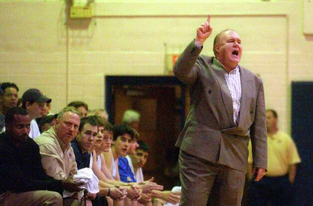 "Alamo Heights basketball coach Charlie Boggess yells instructions to his team during action against Kerrville Tivy in the ""Muledome"" on Tuesday, Jan. 21, 2003. Photo: Express-News File Photo"