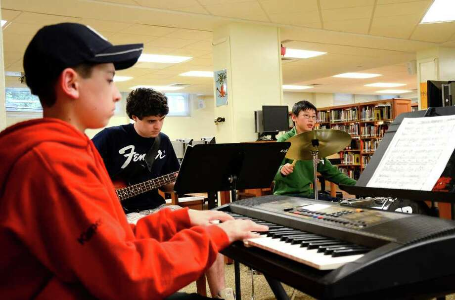 Josh Klapper (Keyboards) of New Canaan, Connor Ackley (Bass) of Darien, and Lucas Fee (Drums) from Darien, of the Young Peoples Jazz Ensemble rehearse at Stamford High School in Stamford, Conn. on May 2, 2011. Photo: James Burns III / Stamford Advocate Freelance
