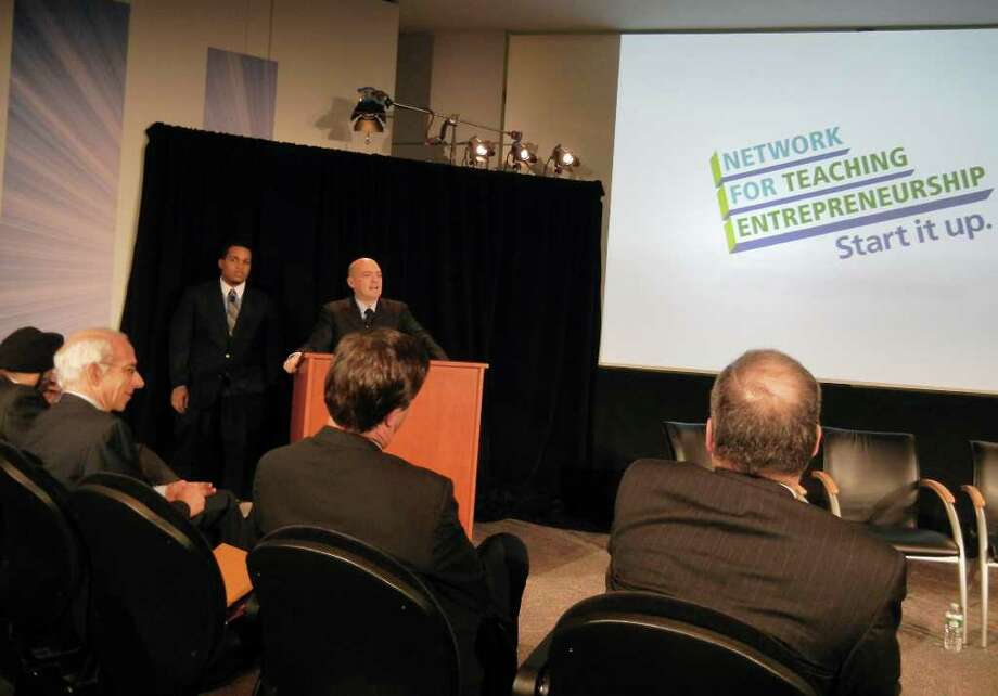 Norwalk resident Jalin Sead, left, represented youths who have benefited from Network for Teaching Entrepreneurship programs at a recent event at MasterCard offices in White Plains, N.Y. Steve Mariotti, founder of the organization, introduces Sead, during the event marking MasterCard's $1 million donation to NFTE.  Contributed photo. Photo: Contributed Photo, ST / Stamford Advocate Contributed