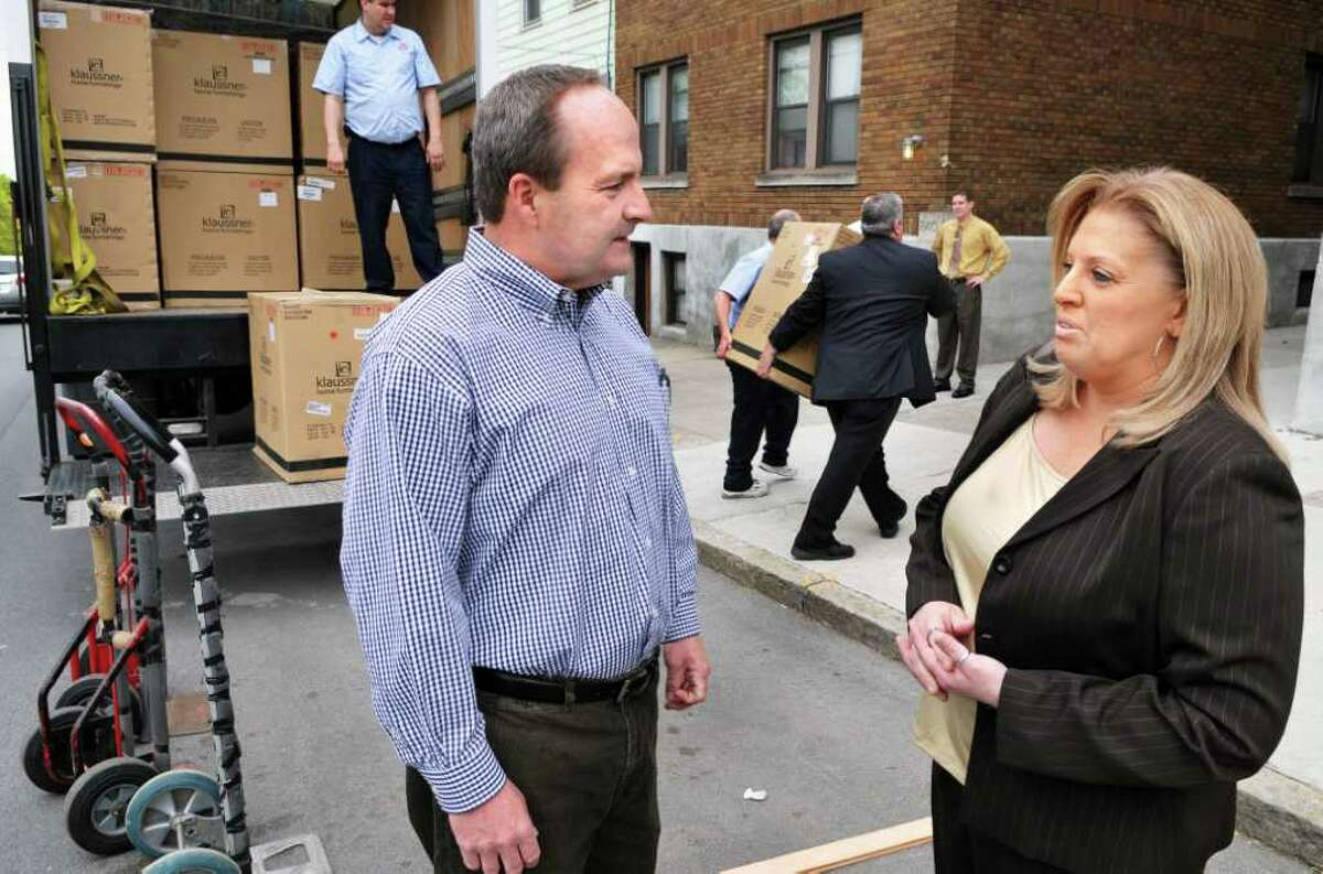 Keith Stack, executive director of the Addictions Care Center of Albany, and Lisa Enes, regional director for Rent-A-Center, outside the ACCA in Albany as Rent-A-Center's donation of $15,000 worth of new furniture is unloaded on Tuesday, May 3, 2011. (John Carl D'Annibale / Times Union)