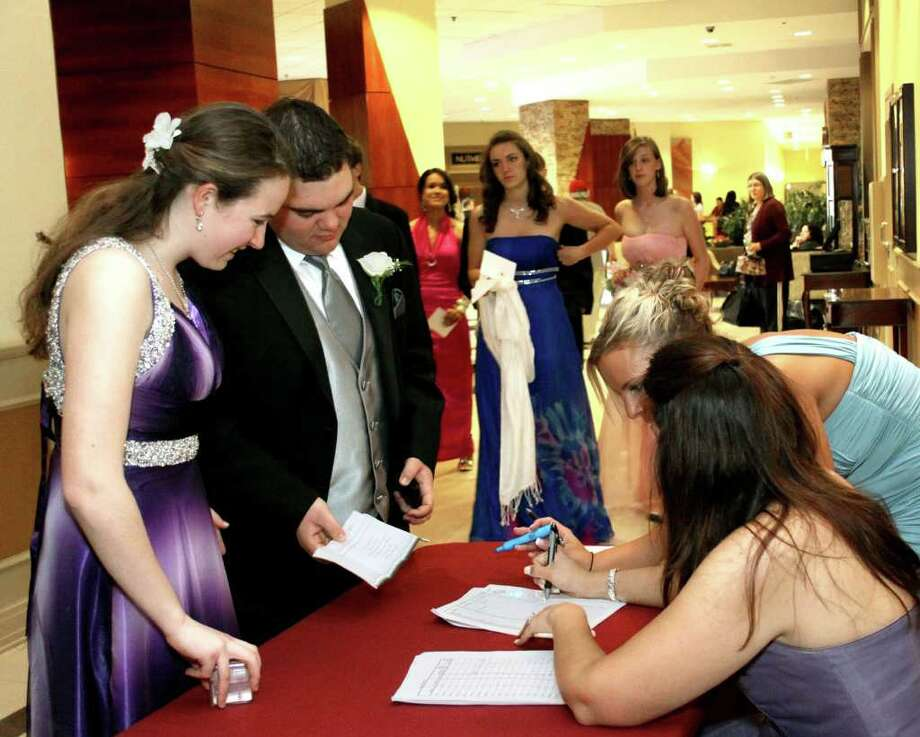 Dates Sarah Smith and Kevin Caruso sign-in for the Newtown Senior Prom. Photo taken 04/30/2011. Photo: Walter Kidd / The News-Times Freelance