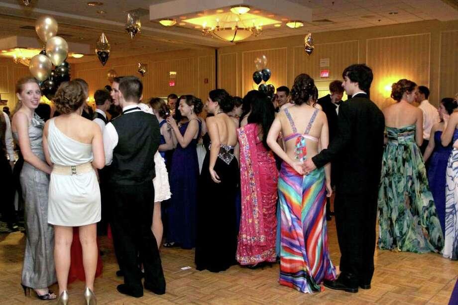 Newtown High School Senior Prom attendees in conversation. Photo taken 04/30/2011. Photo: Walter Kidd / The News-Times Freelance