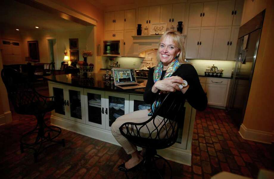 Karen Newton poses for a portrait in her kitchen. Photo: KIN MAN HUI, SAN ANTONIO EXPRESS-NEWS / San Antonio Express-News