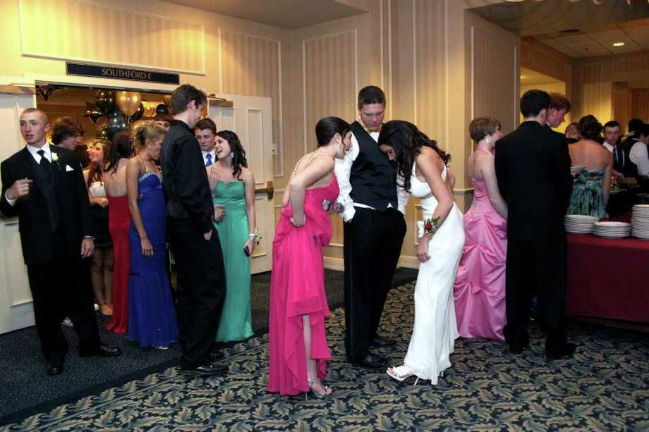 Fashion is a topic, especially when it comes to footware at the Newtown High School Senior Prom. Photo taken 04/30/2011. Photo: Walter Kidd / The News-Times Freelance