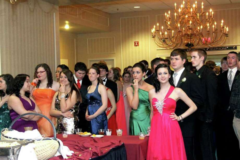 Students wait for a new buffet serving at the Newtown High School Senior Prom. Photo taken April 30, 2011. Photo: Walter Kidd / The News-Times Freelance