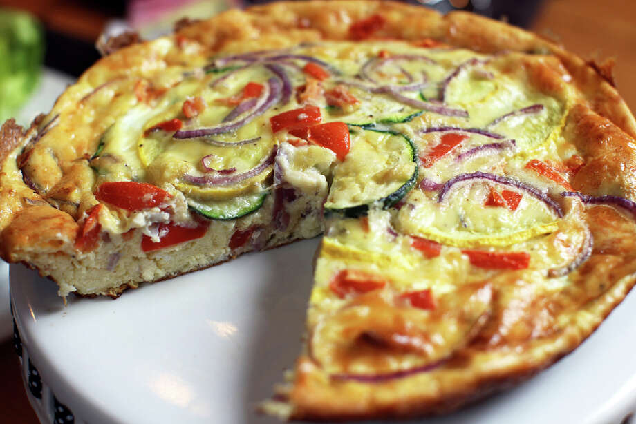 The Pomegranate Frittata — will zucchini, yellow squash, tomatoes and red onion — is a Sunday brunch special. JENNIFER WHITNEY / SPECIAL TO THE EXPRESS-NEWS