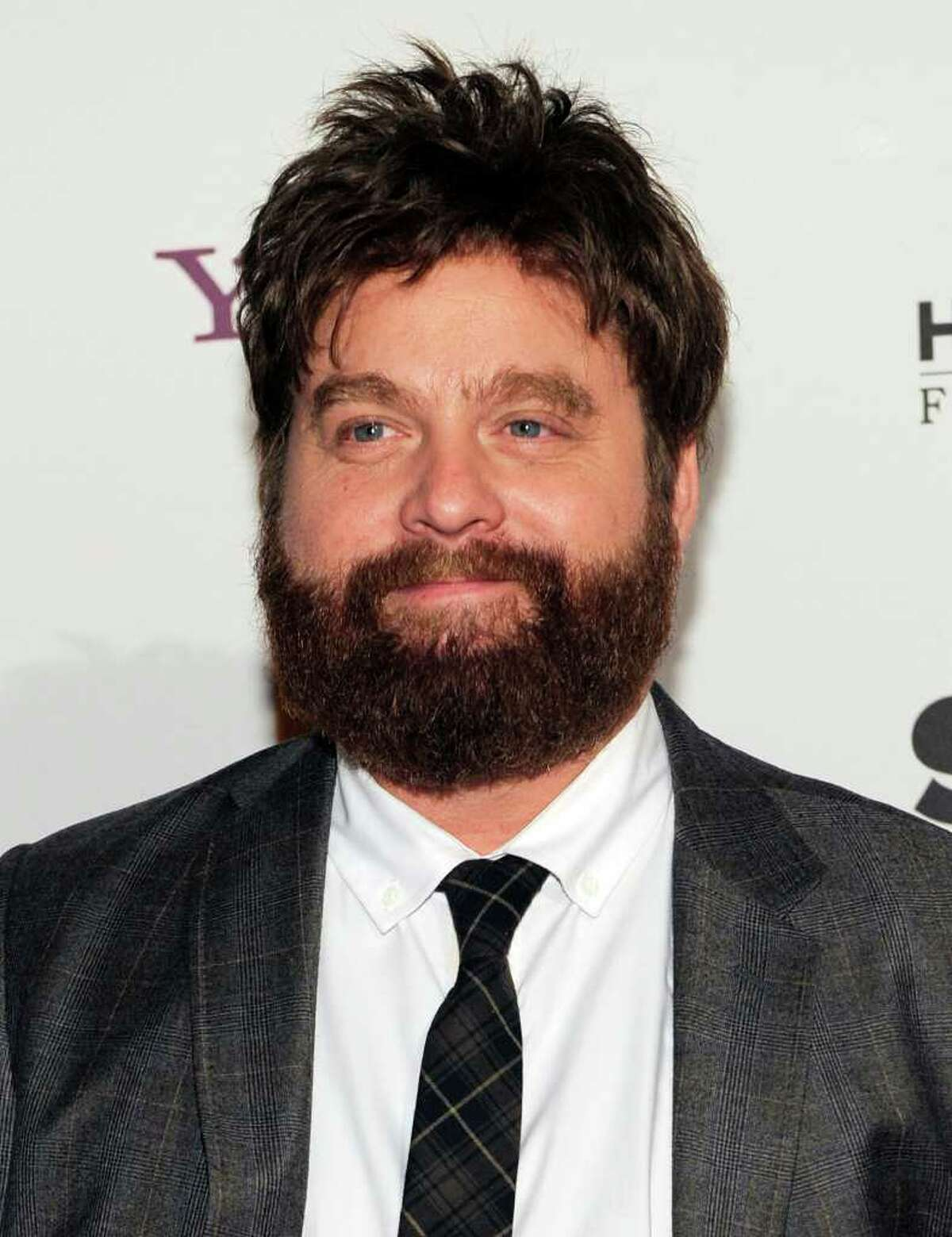 FILE - In this Oct. 25, 2010 file photo, actor Zach Galifianakis arrives at the 14th Annual Hollywood Awards Gala in Beverly Hills, Calif. Galifiankis has led the 15th annual Webby Awards with four awards for his