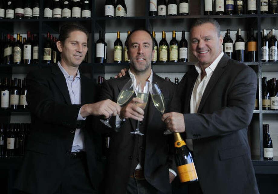Shawn Virene, Grant Cooper and Charles Clark toast their new venture, Brasserie 19. Photo: Karen Warren, Chronicle