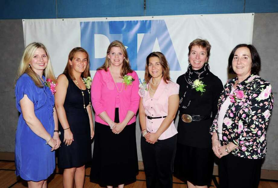 Distinguished teacher honorees from left, Karen Boyea of Greenwich High School, Jennifer Preli of Greenwich High School, Karen Foster of North Mianus School, Meredith Daniels of Riverside School, Nan Nelson of Glenville School and Laura Donnelly of Eastern Middle School, during the Distinguished Teachers Awards Ceremony at Western Middle School in Byram Tuesday afternoon, May 3, 2011. Photo: Bob Luckey / Greenwich Time