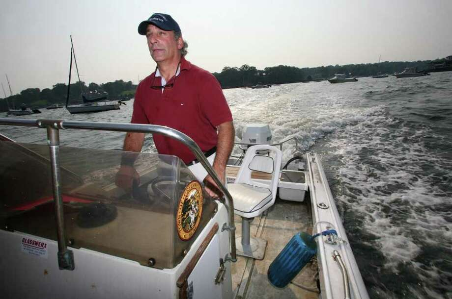 In this August 2009 file photo, Greenwich Harbormaster Jonathan Asch patrols Greenwich Harbor. Photo: File Photo / Greenwich Time File Photo