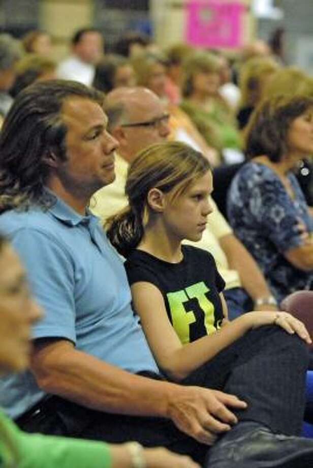 FORUM FOR ALL AGES: Jeff Yanoviak and Ema Yanoviak, 12, listen to the school board candidates for the Katy Independent School District. Photo: Tony Bullard, For The Chronicle