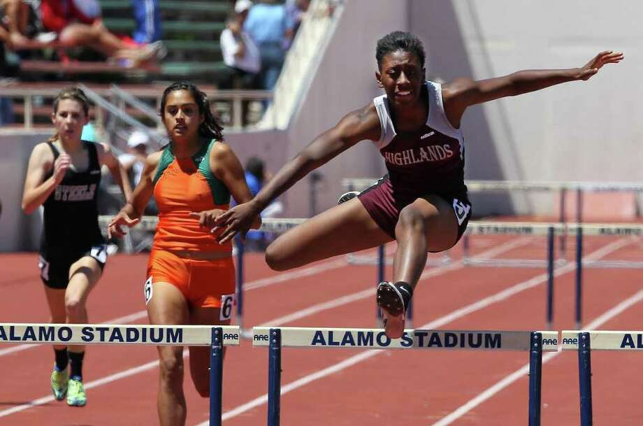 Highlands' Jourdan Doffeny (right) clears the last hurdle to finish first in the 5A women's 300 meter hurdles at the 2011 Region IV Track & Field Meet at Alamo Stadium on Tuesday, May 3, 2011. Photo: Kin Man Hui/kmhui@express-news.net / San Antonio Express-News