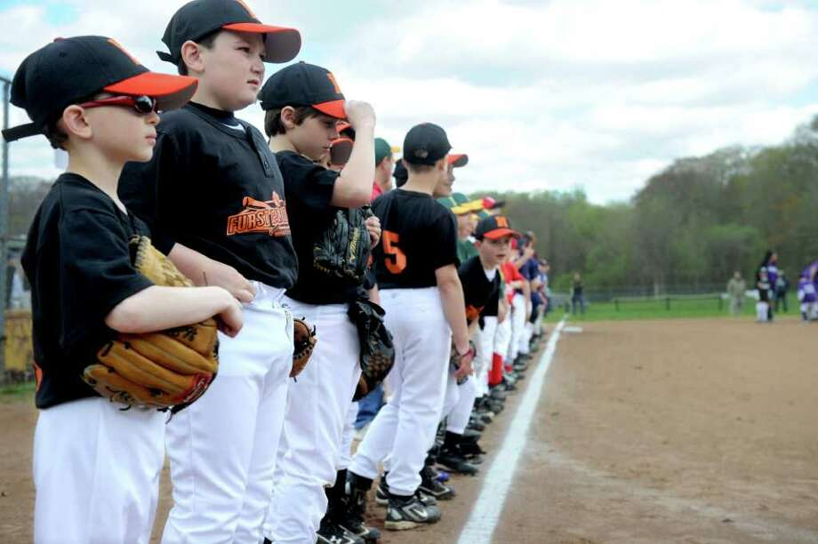 Norwalk Cal Ripken hosts its opening day ceremonies at Fox Run Elementary School on April 30, 2011. Photo: Lindsay Niegelberg / Connecticut Post