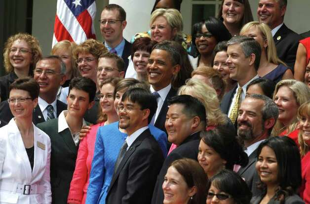 President Barack Obama stands with the 2011 National Teacher of the Year Michelle Shearer, in pink, from Urbana High School in Ijamsville, Md., and State Teachers of the Year, during a ceremony in the Rose Garden of the White House in Washington, Tuesday, May 3, 2011. To the far left, middle row,  is Connecticut Teacher of the Year Kristen Ann Record, a physics teacher at Bunnell High School in Stratford, Conn. (AP Photo/Charles Dharapak) Photo: Charles Dharapak, AP / AP