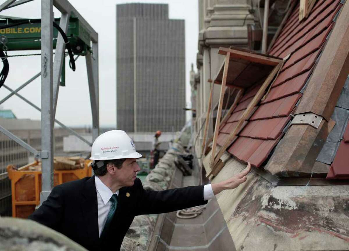 New York Governor Andrew M. Cuomo tours construction on the roof of the State Capitol building in Albany, N.Y. Tuesday, May 3, 2011. (AP Photo/Nathaniel Brooks, Pool)