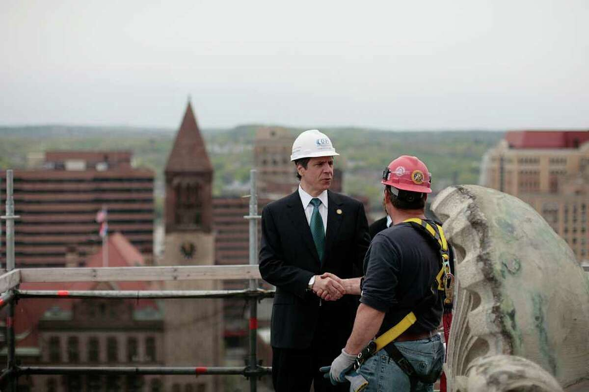 New York Gov. Andrew M. Cuomo greets construction worker Sean Griffin while touring construction on the roof of the State Capitol building in Albany, NY, Tuesday, May 3, 2011. (AP Photo/Nathaniel Brooks, Pool)