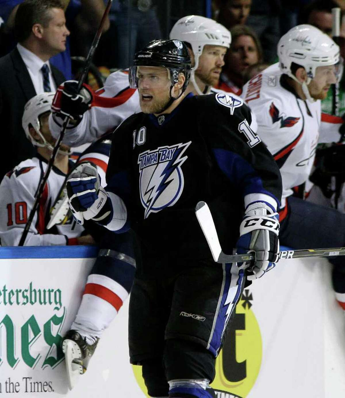 Tampa Bay Lightning left wing Sean Bergenheim (10), of Finland, pumps his fist as he skates past the Washington Capitals bench after his goal during the first period in Game 3 of an NHL hockey Stanley Cup playoffs Eastern Conference semifinal series Tuesday, May 3, 2011, in Tampa, Fla. (AP Photo/Chris O'Meara)