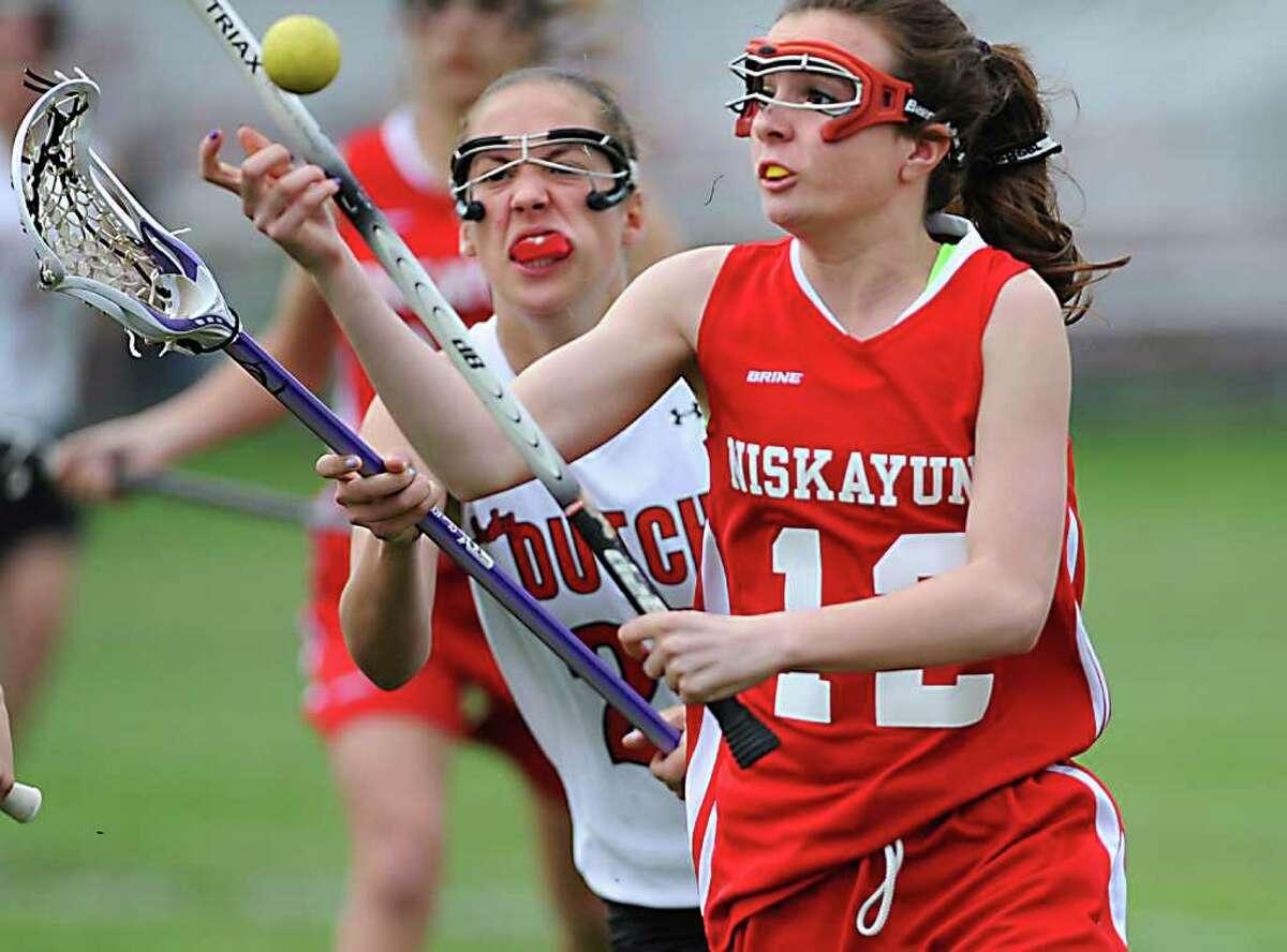 From left, Guilderland's Mackenzie Cietek and Niskayuna's Amanda Welge battle for the ball during a lacrosse game in Guilderland, N.Y. on Tuesday May 3, 2011. (Lori Van Buren / Times Union)