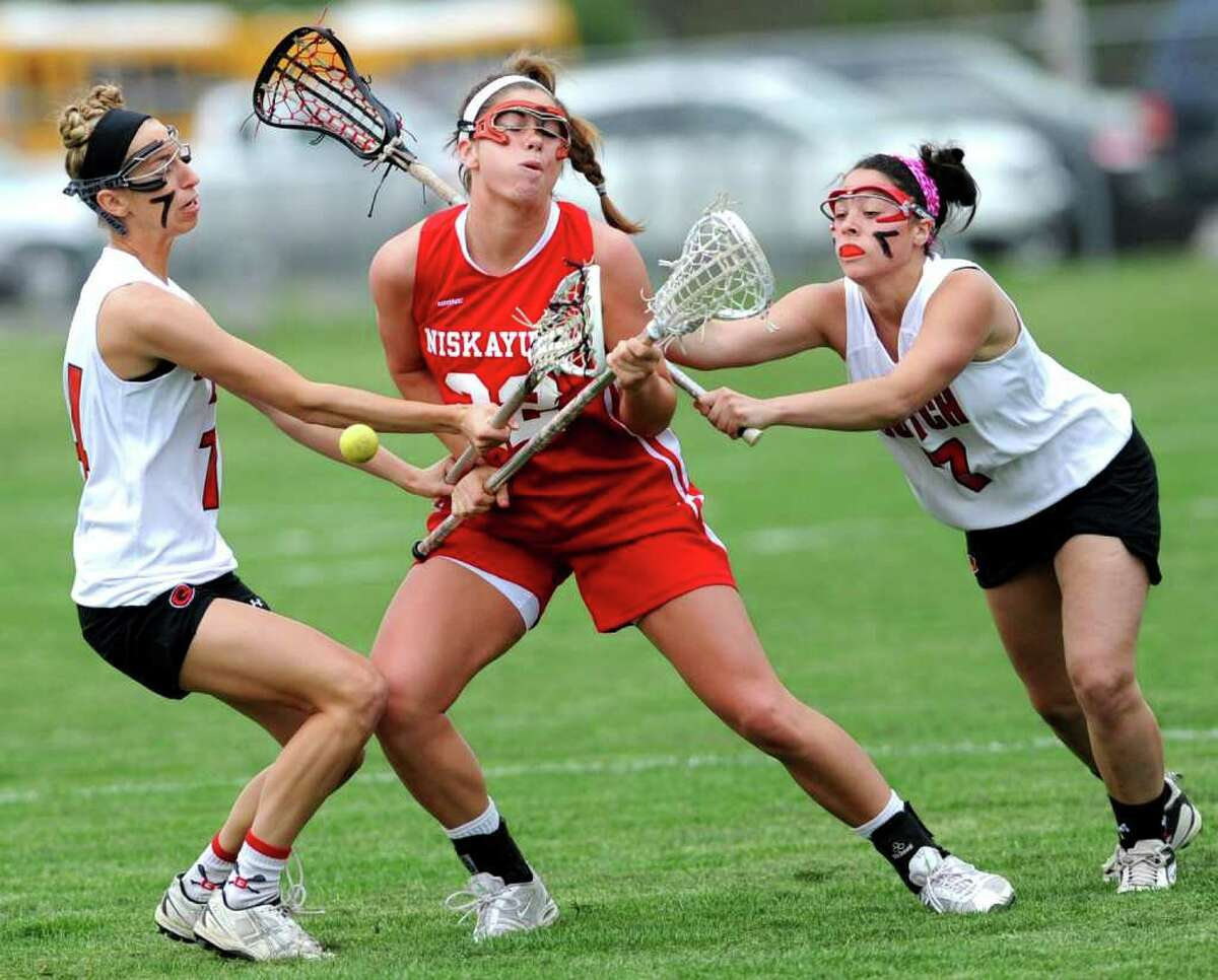 Niskayuna's Kayla Treanor loses the ball as she is double teamed by Guilderland's Erin Mossop, left, and Jenna Walsh during a lacrosse game in Guilderland, N.Y. on Tuesday May 3, 2011. (Lori Van Buren / Times Union)