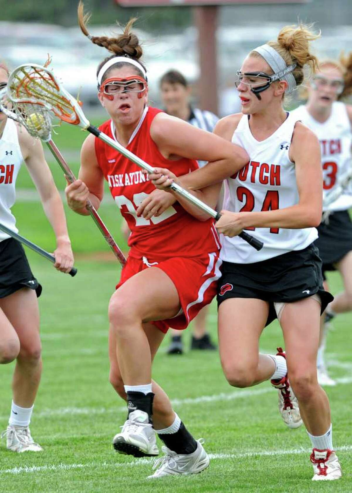 Niskayuna's Kayla Treanor is defended by Guilderland's Shelby Iapoce during a lacrosse game in Guilderland, N.Y. on Tuesday May 3, 2011. (Lori Van Buren / Times Union)