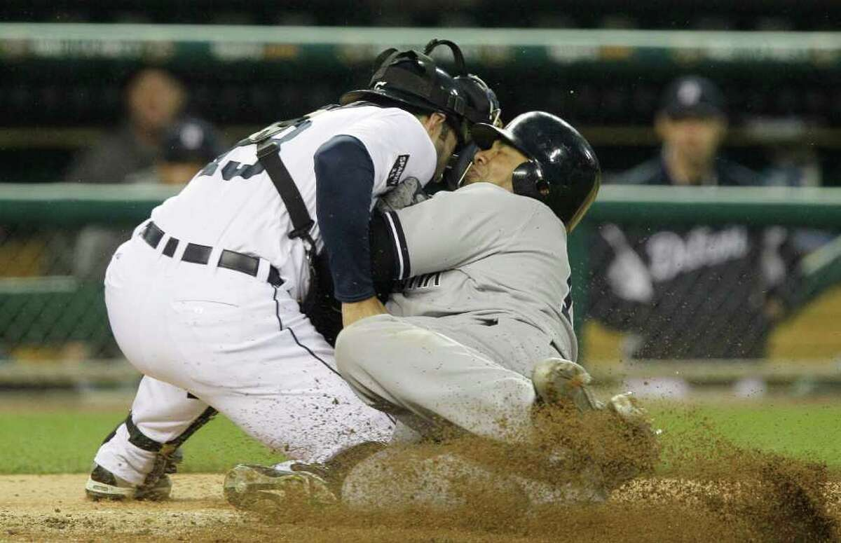 New York Yankees' Andruw Jones, right, is tagged out by Detroit Tigers catcher Alex Avila (13) during the fourth inning of a baseball game, Tuesday, May 3, 2011, in Detroit. (AP Photo/Carlos Osorio)