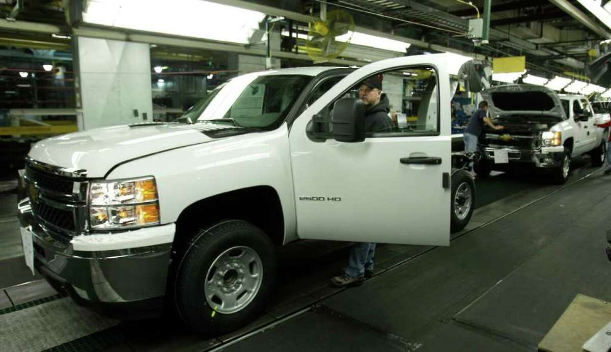 FILE - In this Jan. 24, 2011 file photo, General Motors Silverado and GMC Sierra heavy-duty pickups are assembled at the Flint Assembly in Flint, Mich. General Motors dealers in the United States reported 232,538 total sales in April, a 27-percent increase versus April a year ago. (AP Photo/Carlos Osorio, file)