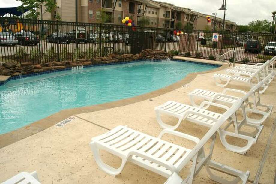 GEORGE WONG: FOR THE CHRONICLE A COOL AMENITY: A view of the swimming pool, one of the on-site amenities at the Avenue Terrace  Apartment Homes, affordable housing units, in the 4000 block of Irvington Boulevard. Photo: For The Chronicle George Wong