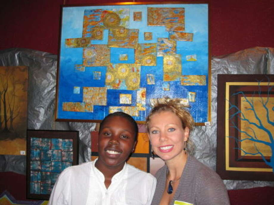 COURTESY PHOTO AUCTION ARTWORK: Spring Branch ISD art student Lakreshia Gadison, left, was featured with art teacher Crystal Fiocchi at last year's Newspring Art Auction. Photo: Courtesy Photo