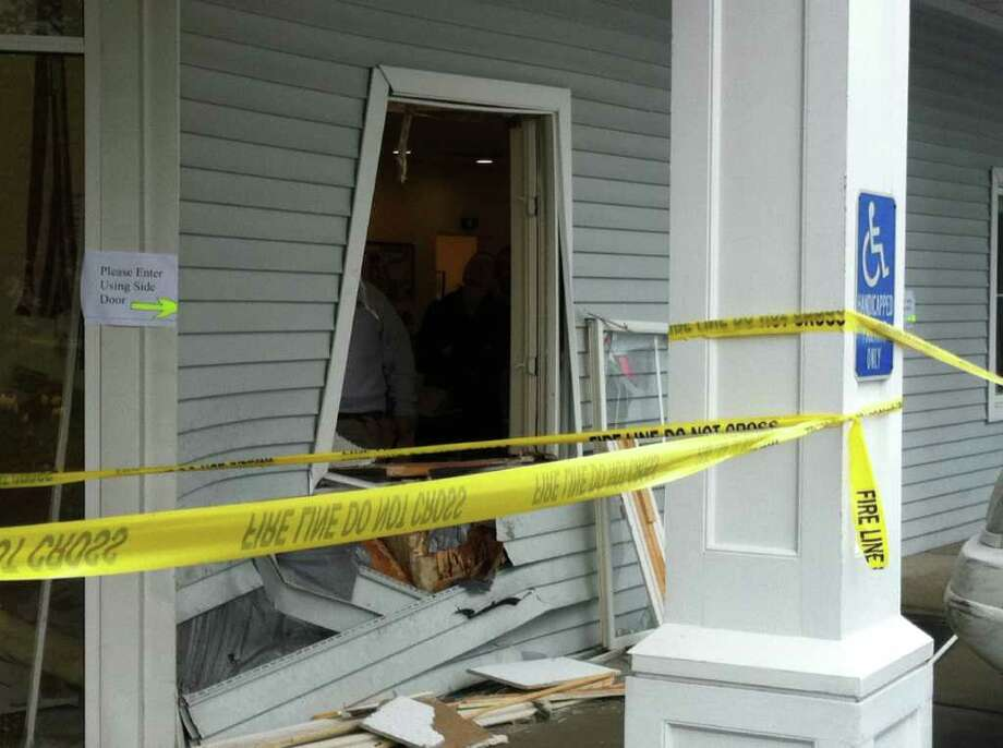 The VCA  veterinary hospital on West Cedar Street was damaged Wednesday morning when a white SUV crashed into the building. Photo: John Nickerson / Stamford Advocate