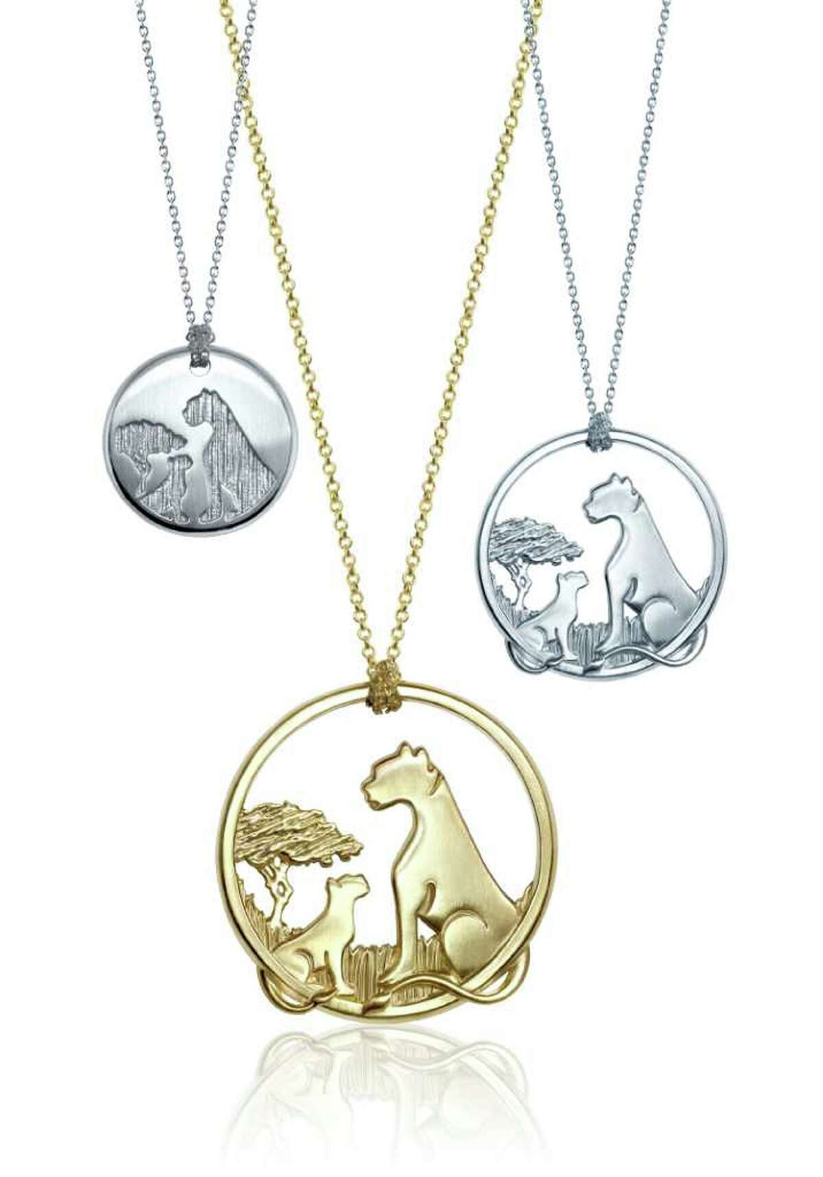 """This product image courtesy of Alex Woo Inc. shows pendants by Alex Woo. The mother big cat keeps her young close to her heart. Jewelry designer Alex Woo saw that up close and personal when she spent time in Africa. Now, as a mother to a toddler, Woo says she feels a kinship to the cats and she tapped into that bond to create a fundraising pendant tied to the new Disney movie """"African Cats."""" (AP Photo/Alex Woo Inc.)"""