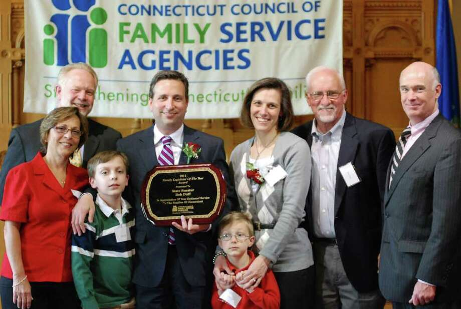After receiving the Family Legislator of the Year Award, state Sen. Bob Duff is joined by his mom Joanne Duff, Dr. William Hass, vice chair of the CCFSA Board of Directors, son Ryan Duff, son Colin Duff, wife Tracey Duff, father Bruce Duff and Rob Cashel, president of Family and Children's Agency in Norwalk, who nominated Bob for the award. Photo: Contributed Photo / Norwalk Citizen