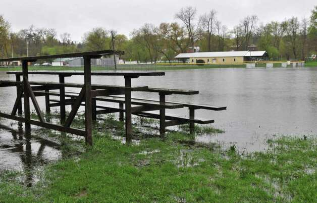 The sports fields at Fort Hardy Park lie flooded after the Hudson River once again overran low-lying areas in Schuylerville on Wednesday, May 4, 2011.  (John Carl D'Annibale / Times Union) Photo: John Carl D'Annibale / 00013036A