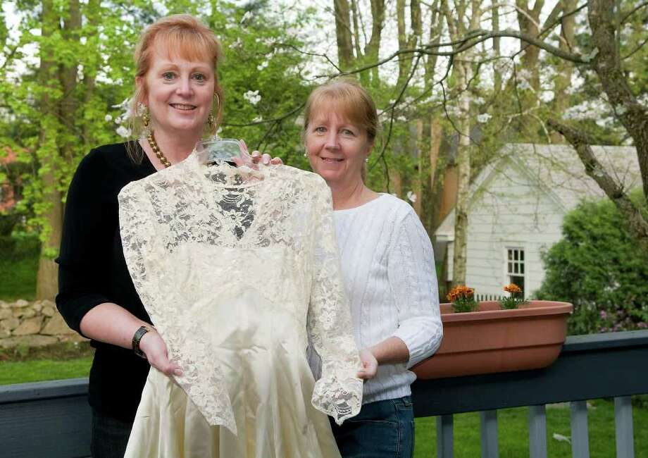 Robin Lawler Pavia, Stamford (left) and her sister Judi Lawler Hasak, Stamford, note the remarkable similarity between the wedding dress they each wore to the dress worn by Kate Middleton for the royal wedding. The sisters' mother, Hedwig Kryswicka Lawler, had selected it and wore it for her own wedding. The sisters display their dress at Robin Pavia's home on Tuesday, May 3, 2011. Photo: Shelley Cryan / Shelley Cryan freelance; Stamford Advocate freelance