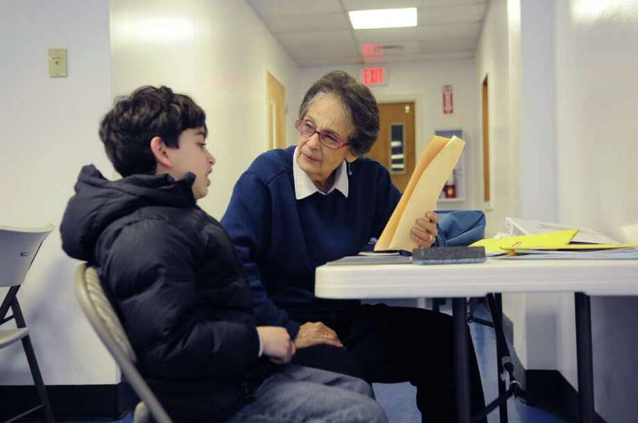Adem Guldal, 8, works with volunteer Joan Lowe at the Byram Archibald Neighborhood Center in Byram on Monday, May 1, 2011. The tutoring is part of the Reading Champions program, which has volunteers work with 350 Greenwich children. Photo: Helen Neafsey / Greenwich Time
