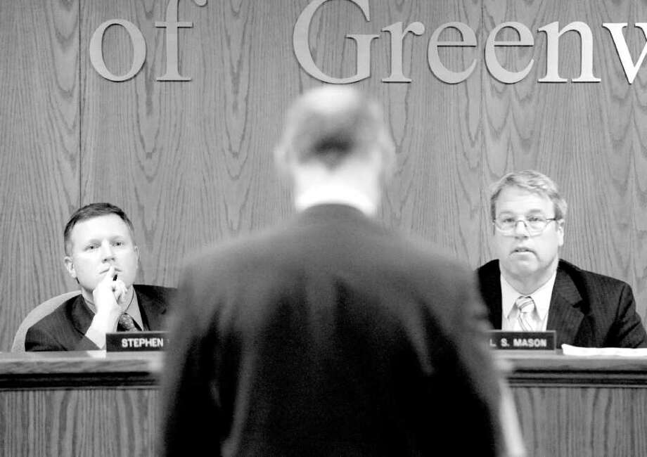 Stephen Walko, left, chairman of the Board of Estimate and Taxation, and Michael Mason, right, a BET member, listen as Greenwich High School Headmaster Chris Winters speak in favor of the MISA project during the Board of Estimate and Taxation public hearing on the town budget at Greenwich Town Hall back in March. RTM members will cast their votes on funding MISA on May 9. Photo: File Photo, ST / Greenwich Time File Photo